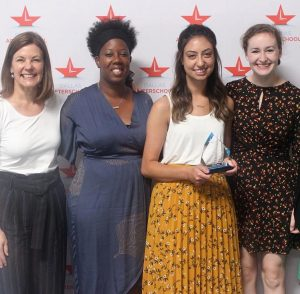 The Heart House staff accepts the Dallas Afterschool Certification Award