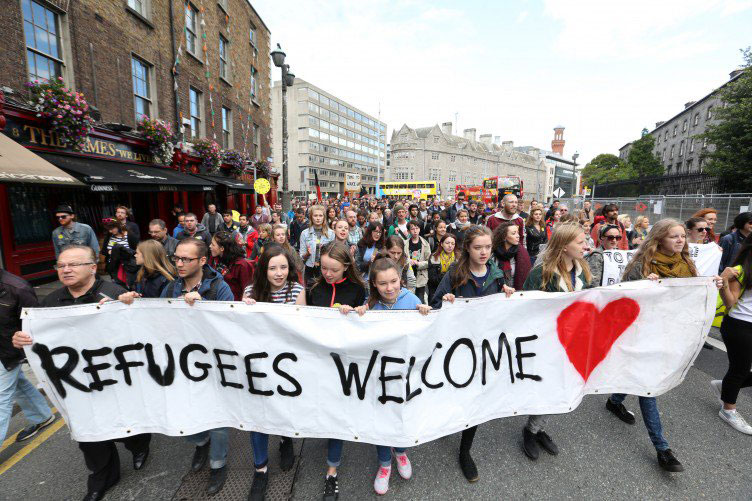 A crowd of activists marching for refugees